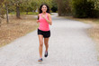 Quadro Fit young woman jogging on a country road