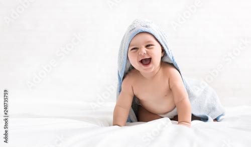 Leinwanddruck Bild Cute little baby boy in hooded towel after bath