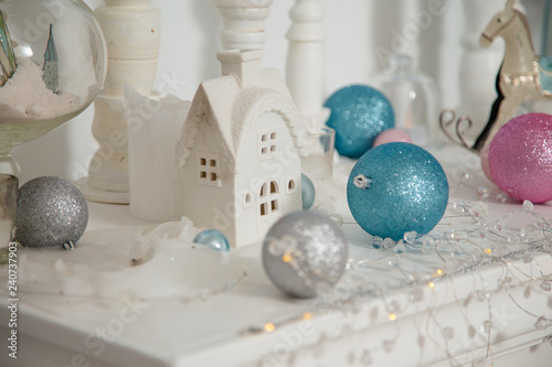 christmas decorations, baubles, toy house and rocking horse on the white background