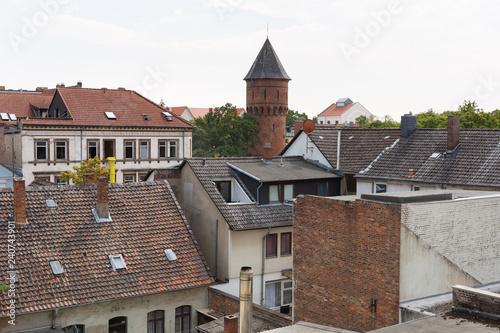 canvas print picture Alte Dächer mit Wasserturm