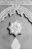 arabic decoration of a wall with an eight-point star and a bow in the socket. Black and white image