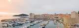 Old seaport panorama of the famous adriatic sea town, Dubrovnik, at fortress walls, with lots of boats and tourists in sunrise - 240761789