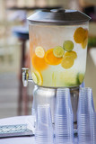 Large container of cold fruit infused water for reception