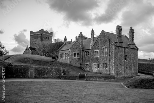 Dover Castle and St Mary in Castro church in the grounds of Dover Castle in England. Black and white.