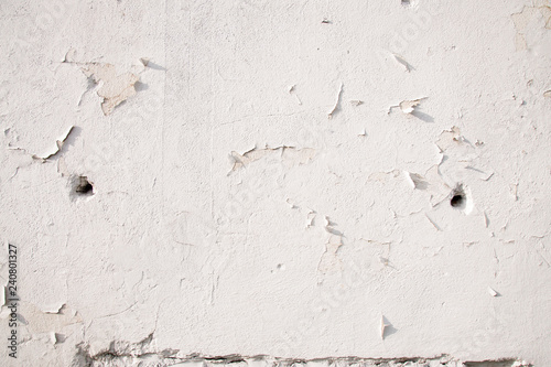 White cracked wall with bullet holes  War conception | Buy Photos