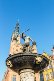 Fountain of the Neptune at sunny day. Old town of Gdansk, Poland