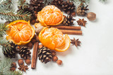 Tangerines without peel, Christmas tree branches, spices, cinnamon, cones on a white stone background. Concept of Christmas, New Year, Mulled Wine - 240832153