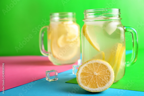 Leinwandbild Motiv Mason jars of fresh lemonade on color background