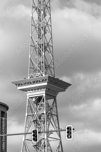 Black and white photo of the landmark Funkturm Berlin (Radio Tower) with foregrounded traffic lights near the Messegelände Berlin (Berlin Trade Fair), Germany