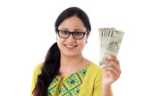 Young woman holding 500 rupee notes against white background