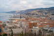Leinwanddruck Bild - TRIESTE, ITALY - JANUARY 14, 2015: The city center and old town of Trieste from above with the old port in the background.