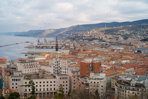 Leinwanddruck Bild TRIESTE, ITALY - JANUARY 14, 2015: The city center and old town of Trieste from above with the old port in the background.