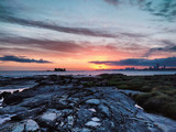 Sunset beyond the island.