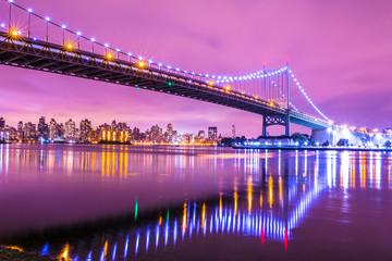 View of RFK Triborough Bridge from Astoria Queens towards Roosevelt Island and Manhattan New York City seen at night