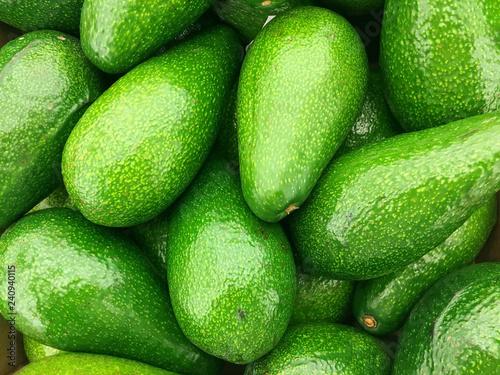 Background of fresh green avocado closeup - 240940115