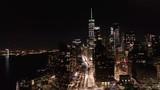 Slow rotation around Lower Manhattan skyline at night - 240953546