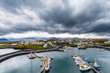 Dark storm clouds over harbor of Stykkisholmur town, Vesturland, Iceland, IS Europe - 240971918