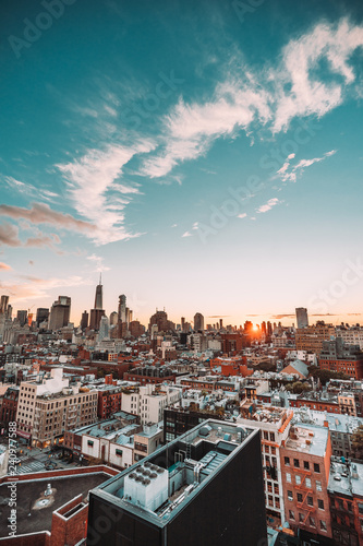 New York City Skyline, rooftop view, sunset, blue cloudy sky