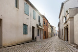 Ancient stone paved street in historic,  medieval, mediterranean, old city Nin in Croatia near Zadar - 240995524