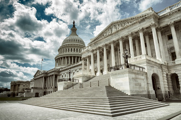 Stark cloudy weather over empty exterior view of the US Capitol Building in Washington DC, USA