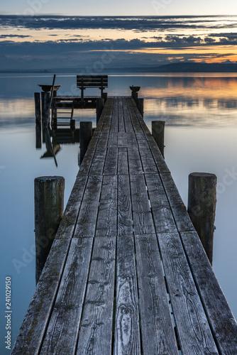 Acrylglas Pier sunset at the lake