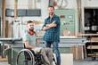 Leinwanddruck Bild - worker in wheelchair in a carpenter's workshop with his colleagu