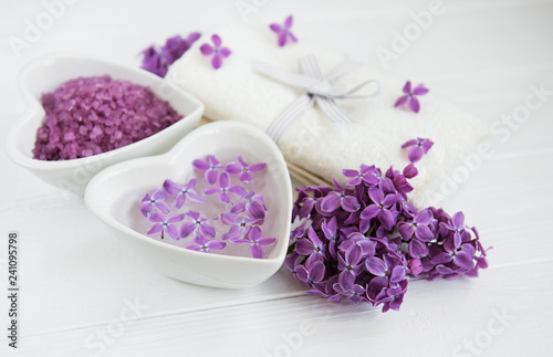 Spa towel and massage products with lilac flowers