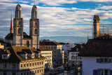 Zurich, Switzerland - view of the Grossmunster church with beautiful mountains in the background