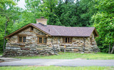 Historic Stone Lodge. Historic stone lodge built by the CCC in the 1930's at Pickett State Park in Jamestown, Tennessee. The cottages and cabins now serve the state park as rentals for visitors. - 241103718