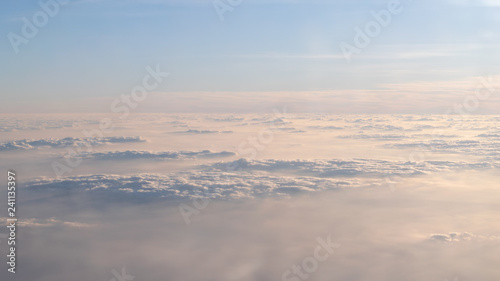 Image of Sunrise above the clouds from airplane window, India - 241135397