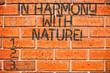 Leinwanddruck Bild - Conceptual hand writing showing In Harmony With Nature. Business photo showcasing Meditation zen peaceful attitude spirituality