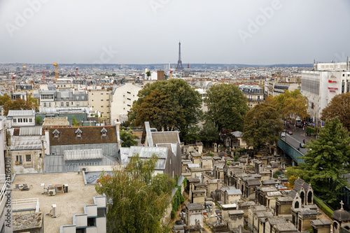 obraz PCV Paris, France - September 22, 2018: View of Eiffel tower and Batignolles cemetery from rooftop in Paris