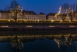 Christmas decorated houses reflecting in the Ljubljanica river - 241173535