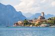 Leinwanddruck Bild - Idyllic coast in Italy: Blue water and a cute village at lago di garda, Malcesine