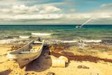 Strand mit Boot in der Karibik
