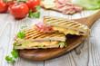 Leinwandbild Motiv Getoastetes und im Kontaktgrill gepresstes italienisches Panini mit Schinken, Käse , Tomaten und Salat  - Pressed and toasted panini with ham, cheese, tomatoes and lettuce