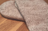 A pair of mittens on wooden table - 241229737
