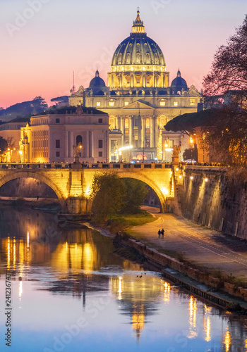 Rome (Italy) - The Saint Peter basilica in Vatican with the dome during the Christmas holidays. Here in particular the Nativity scene and Christmas tree. - 241236743