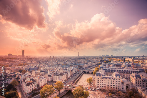 Sunset over the city of Paris France with rooftops seen from above