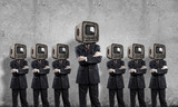 Businessmen with old TV instead of head. - 241269555