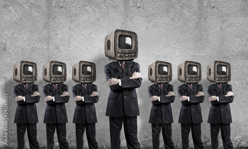 Leinwandbild Motiv Businessmen with old TV instead of head.
