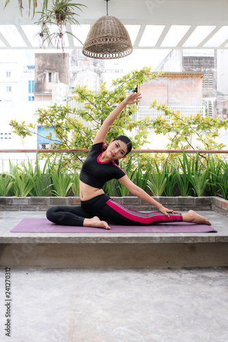 young woman doing yoga on nature