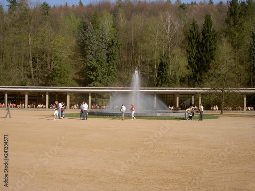 Colonnade of Luhacovice spa, fountain, people, forest and trees in the background
