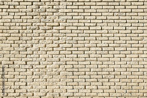 Beige brick wall background texture