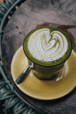 Matcha tea latte art with vegan coconut milk from above. Outdoor coffee shop table - 241295578