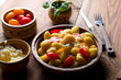 Delicious Italian gnocchi with tomatoes and cheese on wood. - 241309356