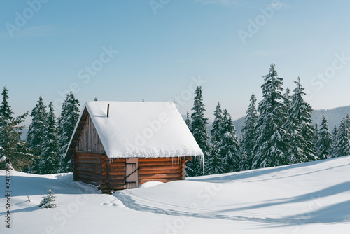 Leinwanddruck Bild Fantastic winter landscape with wooden house in snowy mountains. Christmas holiday concept. Carpathians mountain, Ukraine, Europe