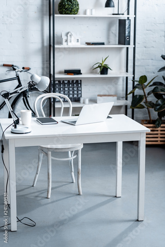 modern office design with white computer desk and rack