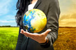 Business woman holding the earth