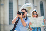 Tourist couple in love enjoying city sightseeing - 241382165